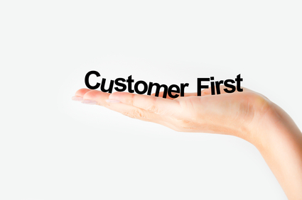 Hand holding letters Customer First